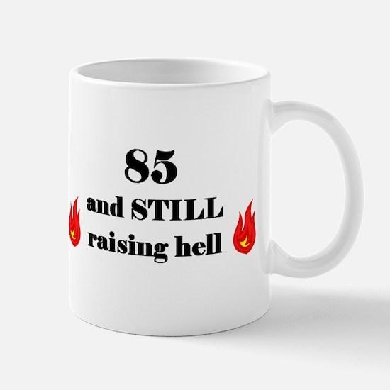 85 still raising hell 2 Mugs