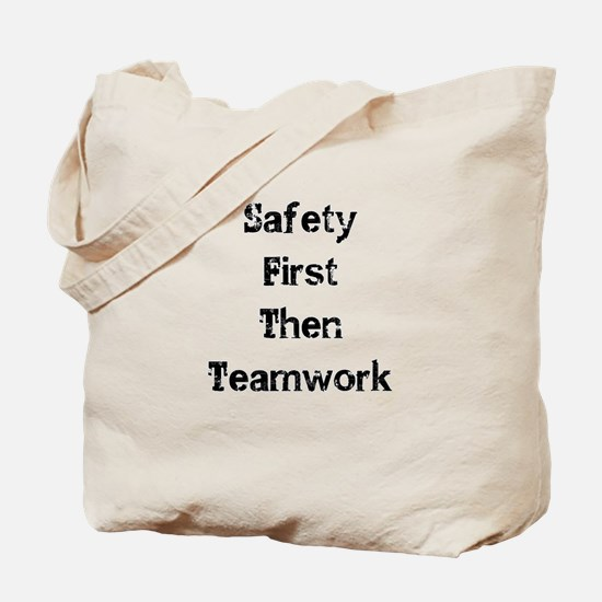 Safety First Then Teamwork Tote Bag