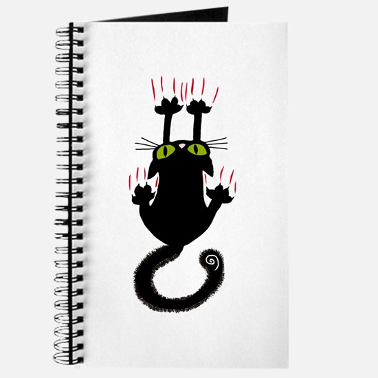 Black cat sliding down Journal