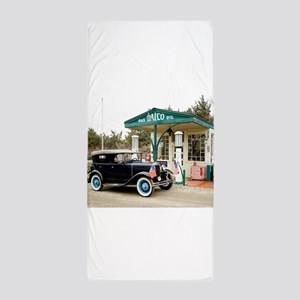 Model A at gas station Beach Towel