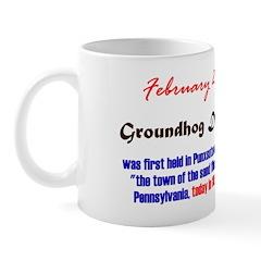 Mug: Groundhog Day was first held in Punxsutawney,