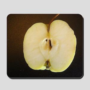 Lopsided sliced apple Mousepad