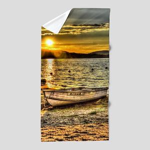 Sun Set over the lake Beach Towel
