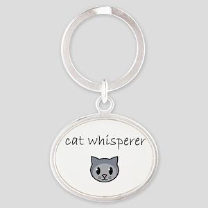 cat whisperer Keychains